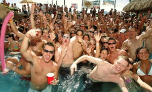 A group of spring breakers parties and considers how to make standing in a pool sound infinitely more fun when they get home.